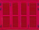 Okno s červenými okenicemi. Zobrazit detail