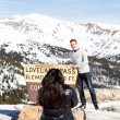 Постер, плакат: People take pictures at Loveland pass