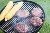 Small summer picnic with hamburgers and corn