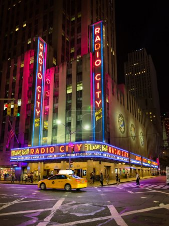 Постер, плакат: NEW YORK CITY JUNE 14 2015: Radio City Music Hall a popular landmark in Manhattan located in Rockefeller Center has hosted the most popular entertainers and artists of the last decades , холст на подрамнике