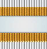 Cigarettes stacked up side by side on pale background