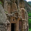 Постер, плакат: Khatchkars and entrance to a monastic cell at Geghard Monastery Armenia