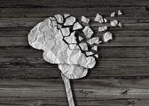 Cervello o lesioni come una salute mentale e il simbolo medico neurologia con un organo umano di pensare fatto di carta sgualcita strappato in pezzi come un concetto creativo per la malattia di alzheimer e demenza
