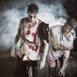 ������, ������: Two male zombies standing on black smoky background