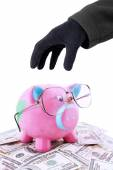 Hand taking piggy bank and money