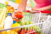 Full shopping cart at supermarket