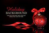 Vánoční pozadí s červeným ornament a hadr na černém pozadí
