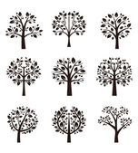 Set of different trees silhouette with roots and branches for logo, label, sign or tattoo. Vector illustration