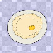 Single large fried egg in plate over blue