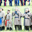 Постер, плакат: Reenactors dressed as Napoleonic war soldiers stand on the battle field
