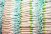 Childrens diapers stacked in a piles in the child room