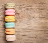 Colorful French Macarons on wooden background