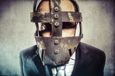 Dangerous business man with iron mask