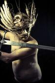 Warrior with helmet and sword