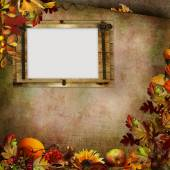 Autumn leaves, berries and  on green vintage background