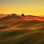 Tuscany, sunset rural landscape. Rolling hills, countryside farm