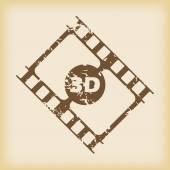 Grungy brown icon with film strip fragment and text 3D on beige background