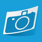 Sticker with camera icon isolated on blue