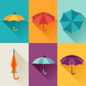 Set of cute multicolor umbrellas in flat design style