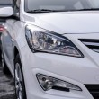 Постер, плакат: Novokuznetsk Russia March 22 2016: Car Hyundai Accent Solaris white car headlights