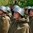Постер, плакат: Soviet soldiers in helmets and cloaks