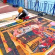 Постер, плакат: Street artist drawing on the floor Street painting