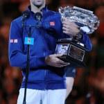 Постер, плакат: Grand Slam champion Novak Djokovic of Sebia holding Australian Open trophy during trophy presentation after victory at Australian Open 2016