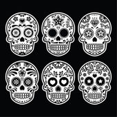 Vector icon set of decorated skull isolated on black background