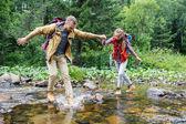 travelers crossing river