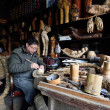 Постер, плакат: Chinese craftsman at work