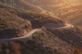 Windy curvy roads through the mountains on a sunset