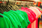 Rows of cotton T-shirts in a large store