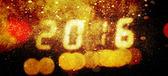 Happy new year 2016 written with Sparkle snow firework backgroun