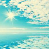 Blue tropical sea and clouds on sky beach.