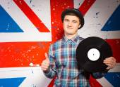 Smiling Man Holding Vinyl Record Showing Thumbs Up