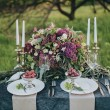 Постер, плакат: Decorated table with bouquet