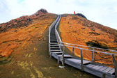 Wooden boardwalk on Bartolome island, Galapagos National Park, E