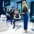 Постер, плакат: Stand of by Panasonic Stylists and makeup artists at work