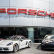 Постер, плакат: Porsche Automobile Dealership and Cars