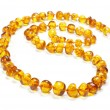 Постер, плакат: Honey amber necklace isolated on the white background
