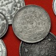 Постер, плакат: Coins of Nepal on red table
