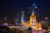 Moscow Business City and Stalin skyscraper building night aerial panorama