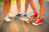 Sneakers of young people on skateboard