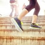 Постер, плакат: Runner running up the stairs