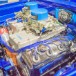 Постер, плакат: Customized muscle car engine displayed