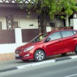 Постер, плакат: Red Hyundai Solaris parked i
