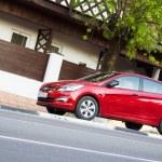 Постер, плакат: New red Hyundai Solaris parked