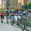 Постер, плакат: NEW YORK CIRCA 2014 Boys sit on a Tandem bicycle on the street In New York City NY USA