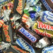 Постер, плакат: Closeup of Snickers Mars Bounty Milky Way Twix candies