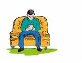 Man in a sofa relaxes while using a touchscreen device